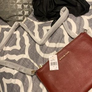 A purse and two wallets
